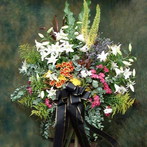 Half Faced Funeral Arrangement With Stand Holland Tulips