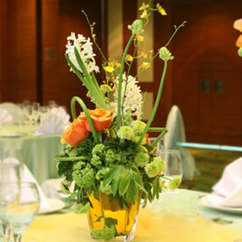 Hyacinth with yellow oncidium orchids floral centerpiece