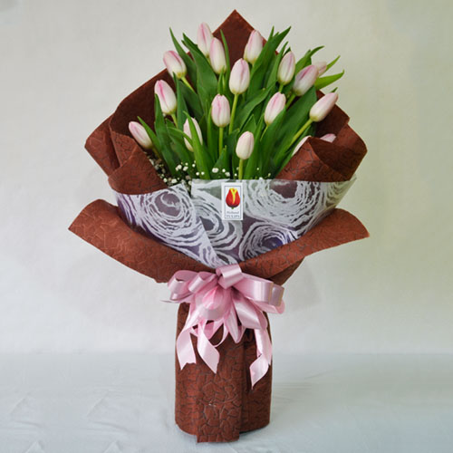 Image result for wo-dozen-multi-colored-dutch-tulips-gypsophila-fillers-eucalyptus-leaves-green-foliages-round-glass-vase holland tulips